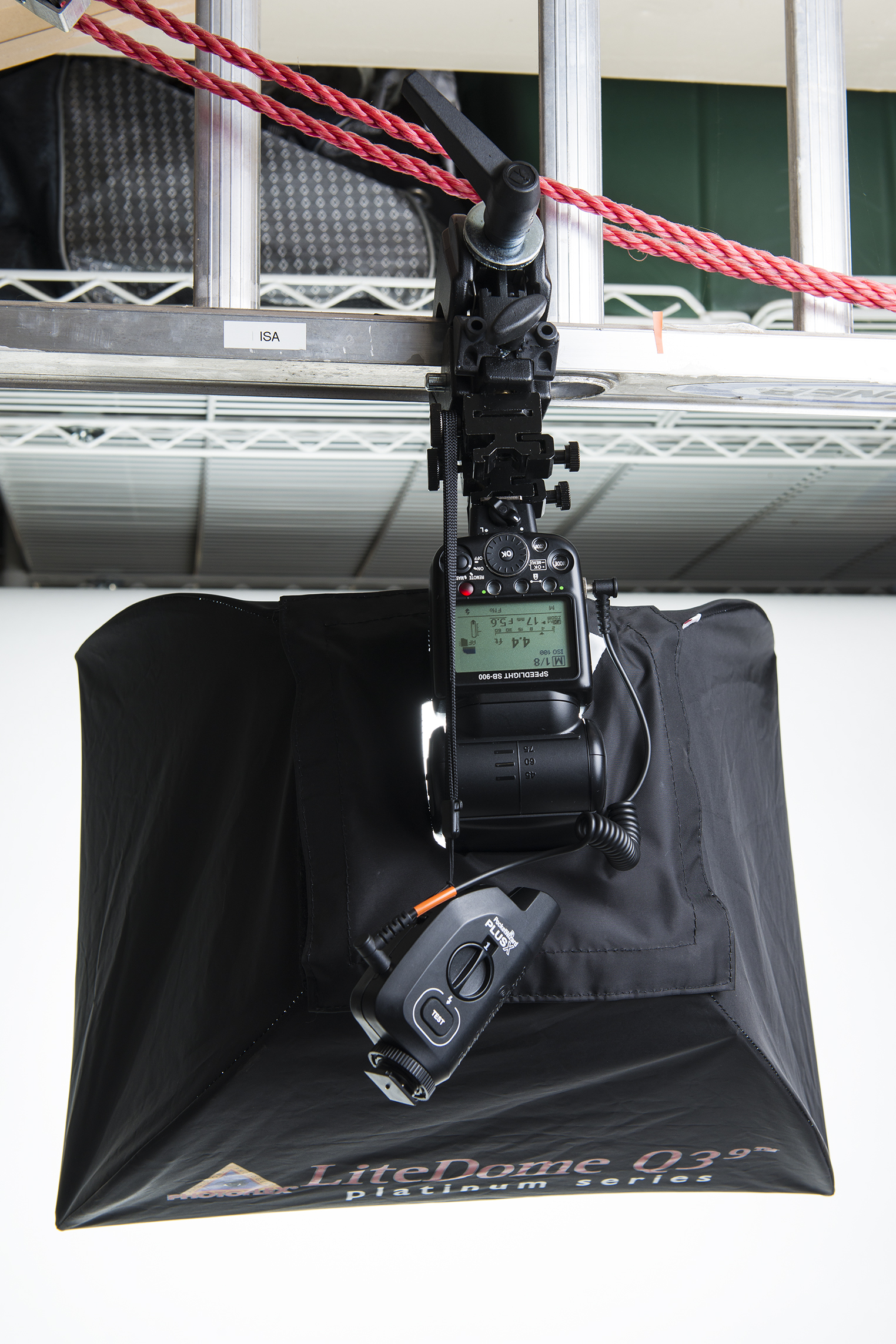 Figure 3.  Flash in a Photoflex softbox being held to a ladder via a Manfrotto C-Clamp.